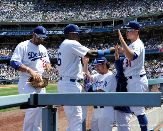 Los Angeles Dodgers Yasiel Puig is greeted by teammates during   game against the San Diego Padres Sunday, May 1,2016 at Dodger Stadium in Los Angeles,California.