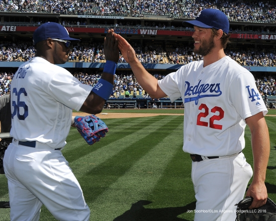 Los Angeles Dodgers Clayton Kershaw and Yasiel Puig celebrate win against the San Diego Padres Sunday, May 1,2016 at Dodger Stadium in Los Angeles,California.
