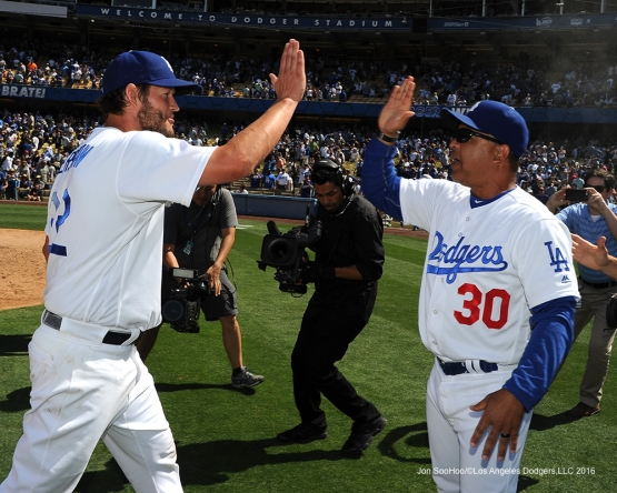 Los Angeles Dodgers Clayton Kershaw and Dave Roberts celebrate win against the San Diego Padres Sunday, May 1,2016 at Dodger Stadium in Los Angeles,California.