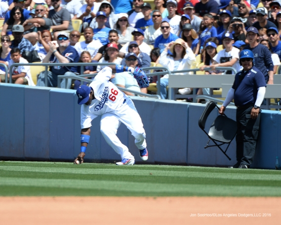 Los Angeles Dodgers Yasiel Puig prior throw to second base against the San Diego Padres Sunday, May 1,2016 at Dodger Stadium in Los Angeles,California.