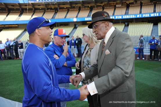Los Angeles Dodgers Dave Roberts talks with Don Newcombe prior to game against the New York Mets Monday, May 9,2016 at Dodger Stadium in Los Angeles,California.  Jon SooHoo/©Los Angeles Dodgers,LLC 2016