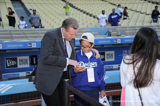Orel Hershiser talks with a young Los Angeles Dodgers fan prior to game against the New York Mets Monday, May 9,2016 at Dodger Stadium in Los Angeles,California.  Jon SooHoo/©Los Angeles Dodgers,LLC 2016