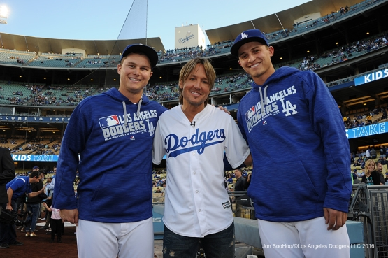 Los Angeles Dodgers Joc Pederson and Corey Seager pose with Keith Urban prior to game against the New York Mets Monday, May 9,2016 at Dodger Stadium in Los Angeles,California.  Jon SooHoo/©Los Angeles Dodgers,LLC 2016