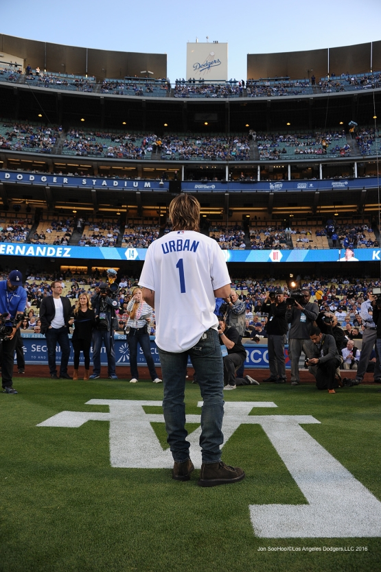 Keith Urban reads the line up before game against the New York Mets Monday, May 9,2016 at Dodger Stadium in Los Angeles,California.  Jon SooHoo/©Los Angeles Dodgers,LLC 2016