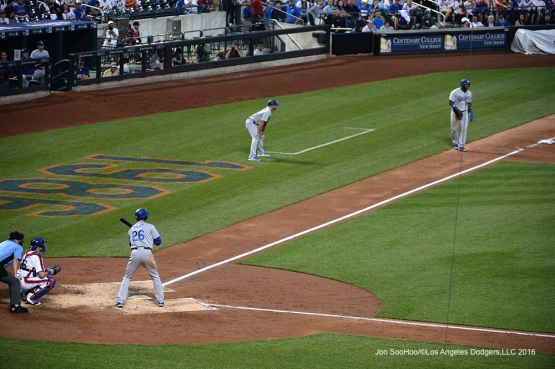 Los Angeles Dodgers Chase Utley about to score Puig during game against the New York Mets Friday, May 27, 2016 at Citi Field in Flushing,New York.