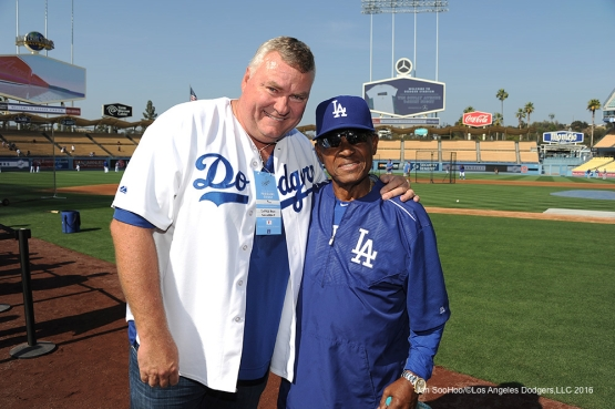 Coffee Bean President and CEO John Fuller poses with Los Angeles Dodgers Manny Mota prior to game against the New York Mets Tuesday, May 10,2016 at Dodger Stadium in Los Angeles,California.  Jon SooHoo/©Los Angeles Dodgers,LLC 2016