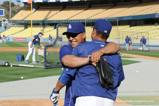 Los Angeles Dodgers Dave Roberts and Juan Castro hug  prior to game against the New York Mets Tuesday, May 10,2016 at Dodger Stadium in Los Angeles,California.  Jon SooHoo/©Los Angeles Dodgers,LLC 2016