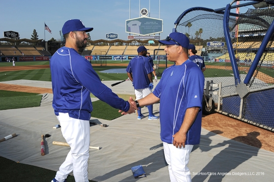 Los Angeles Dodgers Dave Roberts and Andre Ethier shake hands prior to game against the New York Mets Tuesday, May 10,2016 at Dodger Stadium in Los Angeles,California.  Jon SooHoo/©Los Angeles Dodgers,LLC 2016