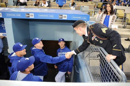 Los Angeles Dodgers Military Hero of the Game Ryan Paul shakes hands with players during game against the New York Mets Tuesday, May 10,2016 at Dodger Stadium in Los Angeles,California.  Jon SooHoo/©Los Angeles Dodgers,LLC 2016