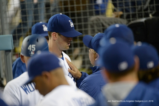 Los Angeles Dodgers Dave Roberts congratulates Alex Wood in the dugout during game against the New York Mets Tuesday, May 10,2016 at Dodger Stadium in Los Angeles,California.  Jon SooHoo/©Los Angeles Dodgers,LLC 2016
