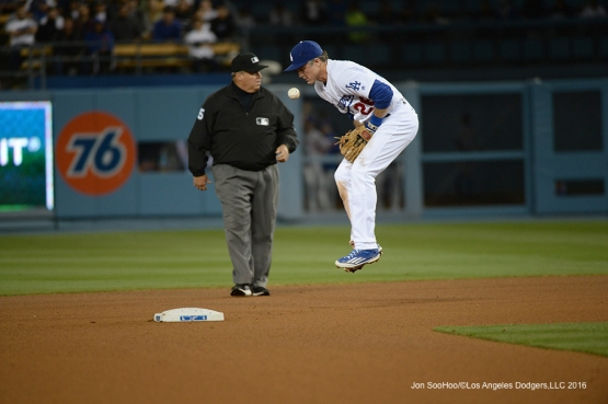 Los Angeles Dodgers Chase Utley catches the outfield throw on a hop during game against the New York Mets Tuesday, May 10,2016 at Dodger Stadium in Los Angeles,California.  Jon SooHoo/©Los Angeles Dodgers,LLC 2016