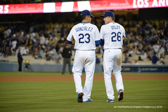 Los Angeles Dodgers Adrian Gonzalez and Chase Utley head to the infield during game against the New York Mets Tuesday, May 10,2016 at Dodger Stadium in Los Angeles,California.  Jon SooHoo/©Los Angeles Dodgers,LLC 2016