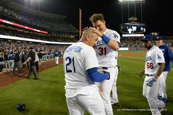 Los Angeles Dodgers Joc Pederson jumps on Trayce Thompson after his walk off home run in the ninth against the New York Mets Tuesday, May 10,2016 at Dodger Stadium in Los Angeles,California. The Dodgers beat the Mets 3-2.  Jon SooHoo/©Los Angeles Dodgers,LLC 2016