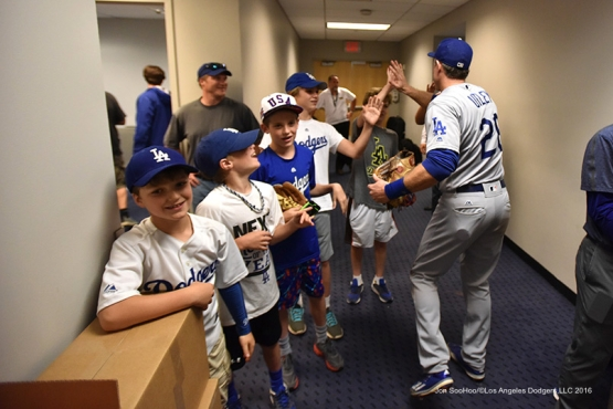 Los Angeles Dodgers Chase Utley celebrates in the clubhouse  after win against the New York Mets Saturday, May 28, 2016 at Citi Field in Flushing,New York.