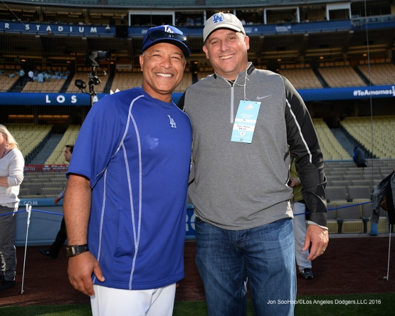 USC Head Football Coach Clay Helton poses with Los Angeles Dodgers Manager and UCLA Bruin alum Dave Roberts pose prior to game against the New York Mets Wednesday, May 11,2016 at Dodger Stadium in Los Angeles,California.  Jon SooHoo/©Los Angeles Dodgers,LLC 2016