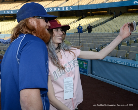 Los Angeles Dodgers Justin Turner poses in selfie with a fan prior to game against the New York Mets Wednesday, May 11,2016 at Dodger Stadium in Los Angeles,California.  Jon SooHoo/©Los Angeles Dodgers,LLC 2016
