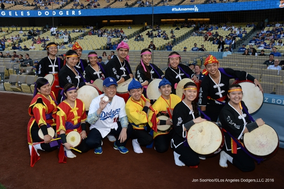 Ryukyukoku Matsuri Daiko pose on the field with the Governor of Okinawa, Mr.Takeshi Onaga  prior to game against the New York Mets Wednesday, May 11,2016 at Dodger Stadium in Los Angeles,California.  Jon SooHoo/©Los Angeles Dodgers,LLC 2016