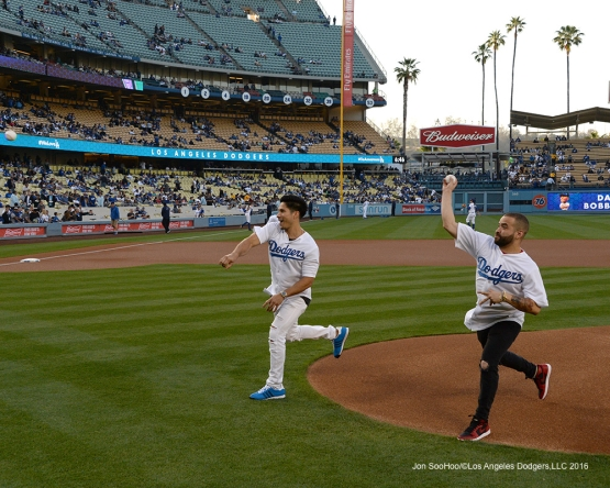 Chino y Nacho throw out the first pitch prior to game against the New York Mets Wednesday, May 11,2016 at Dodger Stadium in Los Angeles,California.  Jon SooHoo/©Los Angeles Dodgers,LLC 2016