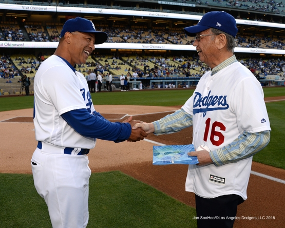 Los Angeles Dodgers Dave Roberts greets Governor of Okinawa, Mr .Takeshi Onaga prior to game against the New York Mets Wednesday, May 11,2016 at Dodger Stadium in Los Angeles,California.  Jon SooHoo/©Los Angeles Dodgers,LLC 2016