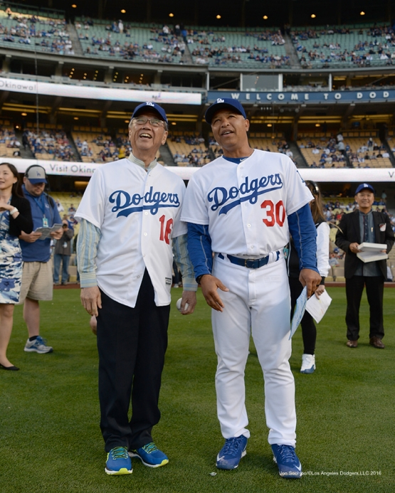 Los Angeles Dodgers Dave Roberts stands with Governor of Okinawa, Mr .Takeshi Onaga prior to game against the New York Mets Wednesday, May 11,2016 at Dodger Stadium in Los Angeles,California.  Jon SooHoo/©Los Angeles Dodgers,LLC 2016