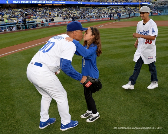 Los Angeles Dodgers Dave Roberts kisses his daughter prior to game against the New York Mets Wednesday, May 11,2016 at Dodger Stadium in Los Angeles,California.  Jon SooHoo/©Los Angeles Dodgers,LLC 2016