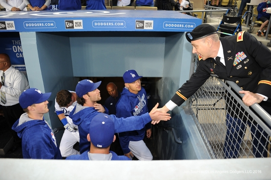 Los Angeles Dodgers Military Hero of the Game US Army Colonel, Lee Reynolds is greeted by players in the dugout during game against the New York Mets Wednesday, May 11,2016 at Dodger Stadium in Los Angeles,California.  Jon SooHoo/©Los Angeles Dodgers,LLC 2016