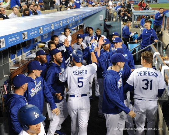 Corey Seager is greeted by teammates in the dugout after hitting a home run  against the New York Mets Wednesday, May 11,2016 at Dodger Stadium in Los Angeles,California.  Jon SooHoo/©Los Angeles Dodgers,LLC 2016