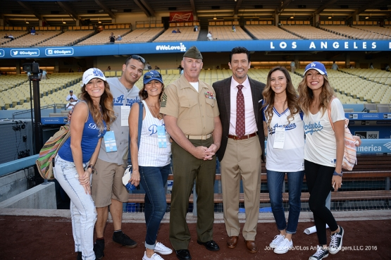 US Marine Corp Sergeant Major, Paul Hayes poses with his family and Nomar Garciaparra prior to game against the New York Mets Thursday, May 12, 2016 at Dodger Stadium in Los Angeles,California.  Jon SooHoo/©Los Angeles Dodgers,LLC 2016