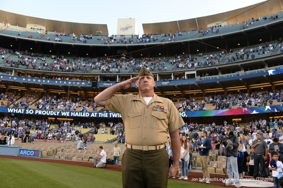 Military Hero of the Game US Marine Corp Sergeant Major, Paul Hayes salutes during the anthem prior to game against the New York Mets Thursday, May 12, 2016 at Dodger Stadium in Los Angeles,California.  Jon SooHoo/©Los Angeles Dodgers,LLC 2016