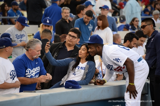 Los Angeles Dodgers Yasiel Puig poses with fan prior to game against the New York Mets Thursday, May 12, 2016 at Dodger Stadium in Los Angeles,California.  Jon SooHoo/©Los Angeles Dodgers,LLC 2016