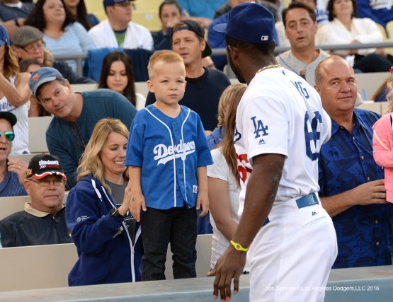 Los Angeles Dodgers Yasiel Puig stares with young fan prior to game against the New York Mets Thursday, May 12, 2016 at Dodger Stadium in Los Angeles,California.  Jon SooHoo/©Los Angeles Dodgers,LLC 2016
