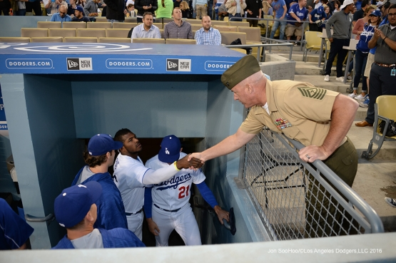 Los Angeles Dodgers Military Hero of the Game US Marine Corp Sergeant Major Paul Hayes shakes hands with players during game against the New York Mets Thursday, May 12, 2016 at Dodger Stadium in Los Angeles,California.  Jon SooHoo/©Los Angeles Dodgers,LLC 2016