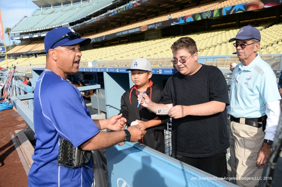 Los Angeles Dodgers Dave Roberts signs for fans prior to game against the St. Louis Cardinals Friday, May 13, 2016 at Dodger Stadium in Los Angeles, California.  Jon SooHoo/©Los Angeles Dodgers,LLC 2016