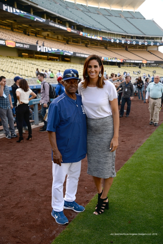 Los Angeles Dodgers Manny Mota poses with Sportsnet LA's Kelli Tennant prior to game against the St. Louis Cardinals Friday, May 13, 2016 at Dodger Stadium in Los Angeles, California.  Jon SooHoo/©Los Angeles Dodgers,LLC 2016