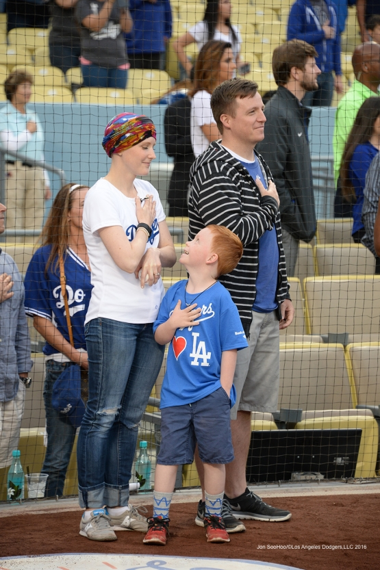 Los Angeles Dodgers Honorary Bat Girl Melissa Stockhoff and family stand for national anthem prior to game against the St. Louis Cardinals Friday, May 13, 2016 at Dodger Stadium in Los Angeles, California.  Jon SooHoo/©Los Angeles Dodgers,LLC 2016