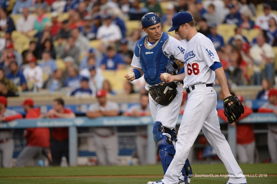 Los Angeles Dodgers  Ross Stripling and A.J.Ellis talk during game against the St. Louis Cardinals Friday, May 13, 2016 at Dodger Stadium in Los Angeles, California.  Jon SooHoo/©Los Angeles Dodgers,LLC 2016