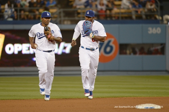 Los Angeles Dodgers Howie Kendrick and Yasiel Puig head to dugout during game against the St. Louis Cardinals Friday, May 13, 2016 at Dodger Stadium in Los Angeles, California.  Jon SooHoo/©Los Angeles Dodgers,LLC 2016