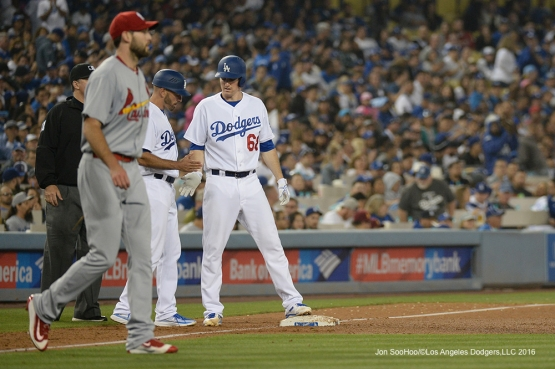 Los Angeles Dodgers Ross Stripling talks to Chris Woodward as college teammate, Cardinals Michael Wacha walks by during game Friday, May 13, 2016 at Dodger Stadium in Los Angeles, California.  Jon SooHoo/©Los Angeles Dodgers,LLC 2016