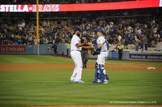 Los Angeles Dodgers Kenley Jansen and A.J.Ellis shake hands after win against the St. Louis Cardinals Friday, May 13, 2016 at Dodger Stadium in Los Angeles, California.  Jon SooHoo/©Los Angeles Dodgers,LLC 2016
