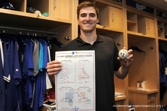 Los Angeles Dodgers Ross Stripling shows proof of his first win beating prior the St. Louis Cardinals Friday, May 13, 2016 at Dodger Stadium in Los Angeles, California.  Jon SooHoo/©Los Angeles Dodgers,LLC 2016