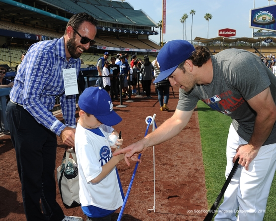 Los Angeles Dodgers Charlie Culberson signs for a fan prior to game against the St. Louis Cardinals Saturday, May 14, 2016 at Dodger Stadium in Los Angeles, California.  Jon SooHoo/©Los Angeles Dodgers,LLC 2016