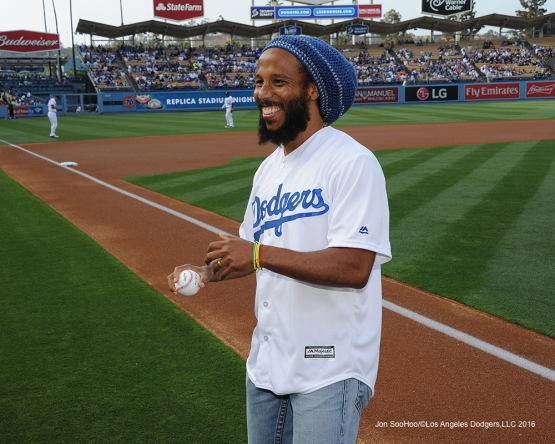 Ziggy Marley on the field Saturday, May 14, 2016 at Dodger Stadium in Los Angeles, California.  Jon SooHoo/©Los Angeles Dodgers,LLC 2016