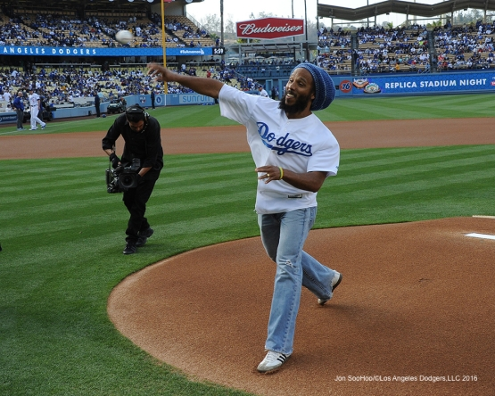 Ziggy Marley throws out the first pitch Saturday, May 14, 2016 at Dodger Stadium in Los Angeles, California.  Jon SooHoo/©Los Angeles Dodgers,LLC 2016