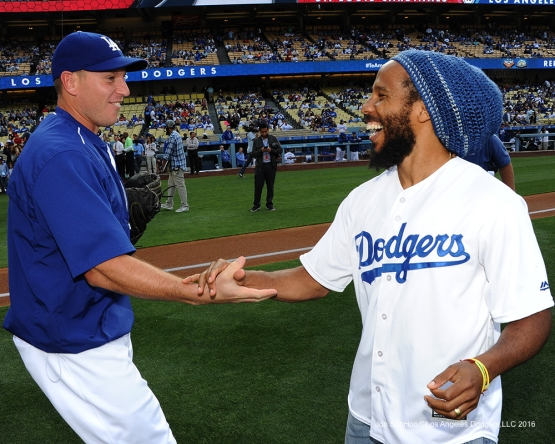 A.J. Ellis shakes hands with Ziggy Marley on the field Saturday, May 14, 2016 at Dodger Stadium in Los Angeles, California.  Jon SooHoo/©Los Angeles Dodgers,LLC 2016