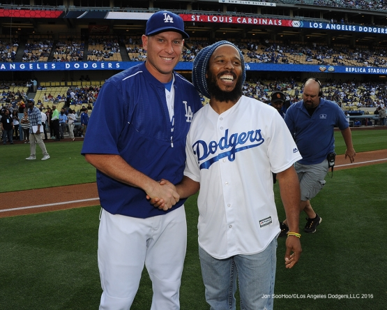 A.J. Ellis shakes poses with Ziggy Marley on the field Saturday, May 14, 2016 at Dodger Stadium in Los Angeles, California.  Jon SooHoo/©Los Angeles Dodgers,LLC 2016