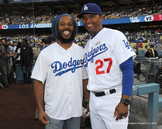 George Lombard poses with Ziggy Marley on the field Saturday, May 14, 2016 at Dodger Stadium in Los Angeles, California.  Jon SooHoo/©Los Angeles Dodgers,LLC 2016