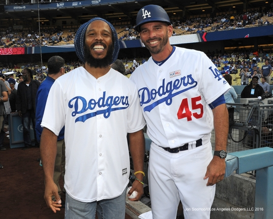 Chris Woodward poses with Ziggy Marley on the field Saturday, May 14, 2016 at Dodger Stadium in Los Angeles, California.  Jon SooHoo/©Los Angeles Dodgers,LLC 2016