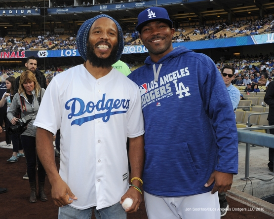 Howie Kendrick poses with Ziggy Marley on the field Saturday, May 14, 2016 at Dodger Stadium in Los Angeles, California.  Jon SooHoo/©Los Angeles Dodgers,LLC 2016