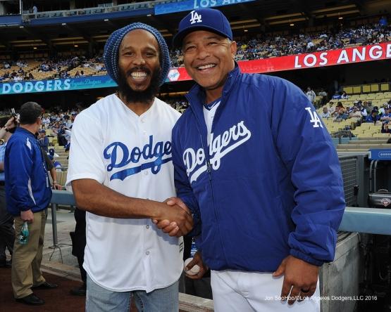 Dave Roberts poses with Ziggy Marley on the field Saturday, May 14, 2016 at Dodger Stadium in Los Angeles, California.  Jon SooHoo/©Los Angeles Dodgers,LLC 2016