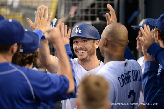 Los Angeles Dodgers Scott Kazmir is greeted in the dugout after scoring against the St. Louis Cardinals Saturday, May 14, 2016 at Dodger Stadium in Los Angeles, California.  Jon SooHoo/©Los Angeles Dodgers,LLC 2016